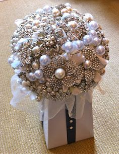 This is the #1 Best DIY Wedding Bridal Brooch Bouquet Video Tutorial on-line. See how you can make your own brooch bouquet for your wedding. Make one just for the bride on her special day or make several smaller ones for your bridesmaids. You'll be surprised by how easy and affordable it is to do-it-yourself. Brooch Bouquets would even work for quinceañera parties, sweet 16 parties and more.