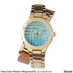You'll love the way this Women's Wrap-around Watch fits on your wrist. The Urban Oasis Women's Wraparound Gold Watch designed by Artist C.L. Brown features an abstract kinetic light painting design enhanced with Photoshop. Own a unique timepiece for yourself! Watch is 3-hand analog Japan Quartz® with a buckle closure and comes with a battery. Watches are water resistant up to 3 ATM and come with a 1 year manufacturer's limited warranty. This product is recommended for ages 13+.