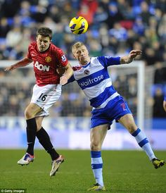 Aerial combat: Michael Carrick and Pavel Pogrebnyak challenge for the ball in the air Michael Carrick, Van Persie, Sir Alex Ferguson, Wayne Rooney, Roller Coaster, Manchester United, Victorious, Thriller, Robin