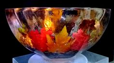 Autumn themed ice bowl with leaves frozen in.