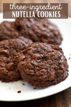 Three-Ingredient Nutella Cookies are ready in minutes and made with only three ingredients. Chewy, fudgy and chocolatey, they're sure to be everyone's favorite treat! #bakedgoods #cookies #nutella #chocolate
