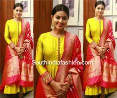 Actress Sneha Prasanna was recently seen in a parrot green floor length anarkali suit paired with contrast red Banarasi silk dupatta.