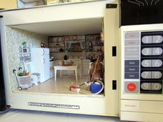 Sonia made this awesome kitchen miniature scene inside an old broken microwave oven. It had everything you would find in a kitchen including a broken egg on the linoleum!