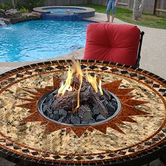 Talk about gathering round the fire: With this 5-foot-wide mosaic-pattern tabletop, the fire is the centerpiece. There's still plenty of room to eat while flames lick the concrete logs — 70,000 BTUs' worth of flames, in fact. (The propane tank is hidden discreetly under the table.)