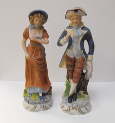 Metzler & Ortloff, Ilmenau, Thuringia Each standing on a rounded base. Height: approx. 21 cm Biscuit porcelain,. Painted in bright colours. Marked on the bottom: company mark (blue under glaze stamp) Insured shipping.
