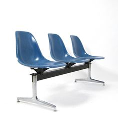 Ray & Charles Eames made by Herman Miller / Vitra - Seating Bench / tandem seating with blue fibreglass shells.