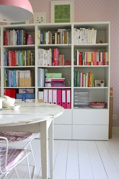 Eclectic Home Office with Modern White Ikea Storage Ideas Artistic Painting Nice Wallpaper Round White Table Wire Chairs