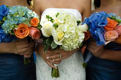 Blue and orange flowers - perfect for reception tables!
