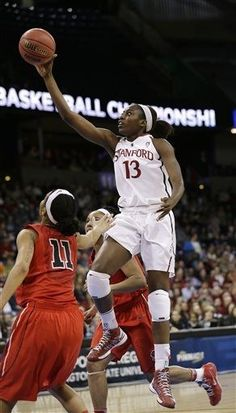 Stanford's Chiney Ogwumike drives past Georgia defenders in the first half of a regional semifinal in the NCAA women's college basketball tournament