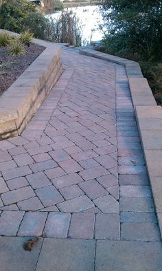 Tumbled Cobblestone Concrete Paver Walkway with Tumbled Wall Block and Cap Retaining Wall