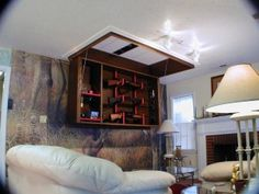 Secret Rifle Display Cabinet Folds Automatically from Ceiling