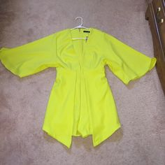 Yellow romper dress Yellow romper dress. Bought from a boutique in Philly. Worn once! Dresses Mini
