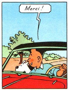 """Tintin sont dans une voiture. Milou et Tintin regardent par la fenêtre de la voiture. Tintin dit """"merci""""."""