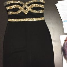 Gold sequin bandage dress from Rickety Rack Short, black bandage dress with gold sequins design on top. Size Large. Bought it from Rickety Rack website for $120. Have NEVER been worn. Is in perfect condition! Great for New Years Eve!! Dresses Mini