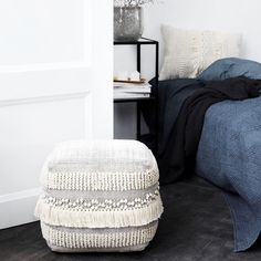 This stunning Moroccan pouf by House Doctor is as textured as it is versatile. Whether you use as a footstool, an extra seat, or a coffee table.