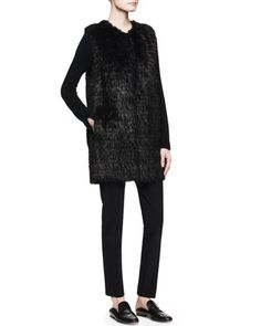 """Lasfer Long Fur Vest and Lunette V-Neck Cashmere Top by THE ROW at Neiman Marcus. Lasfer Long Fur Vest:      Long dyed beaver (Canada) fur vest by The Row.     Approx. 32""""L front and 34""""L back.     Round neckline.     Open front.     Hem falls to mid-thigh.     Made in the USA of Canadian material."""