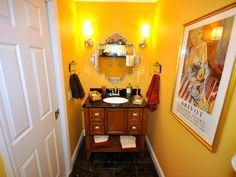 A small-scale space like a powder room is the perfect place to experiment with big and bold style. Wow your guests with arresting wallpaper, vivid paint, entire walls of tile and out-of-this world accessories.