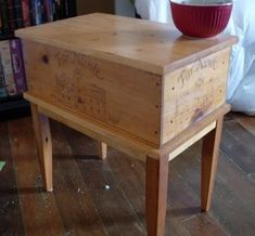 Wine crate end table with legs.