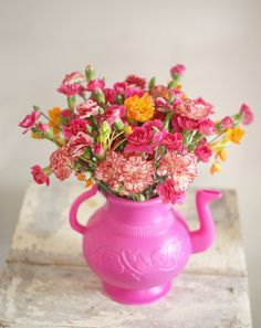 Flowers in teapots are one of my favourite things - even little plastic teapots!
