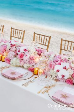 A stunning floral runner made up of orchids, roses, and hydrangeas creates a chic head table. http://www.colincowieweddings.com/honeymoon-and-destination/beach-chic-bahamas-wedding