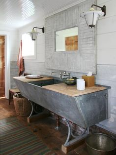 Make your bathroom stand out with a one-of-a-kind vanity. You can put a sink on almost anything! Rescued Cow Trough When New York design firm Carrier and Company converted an old dairy barn into a. Barn Bathroom, Rustic Bathrooms, Bathroom Vanities, Bathroom Ideas, Industrial Bathroom, Bathroom Cabinets, Bathroom Designs, Bathroom Modern, Bathroom Inspiration