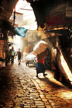 Brick street, morning light, and Delhi. This is what a lot of Indian cities look like.