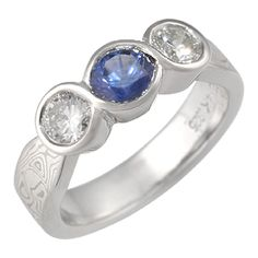 This is very close to the ring I am getting made from my jeweller. The diamond will be in the center flanked by a sapphire and an imperial topaz but there won't be any filigree. So excited!!!