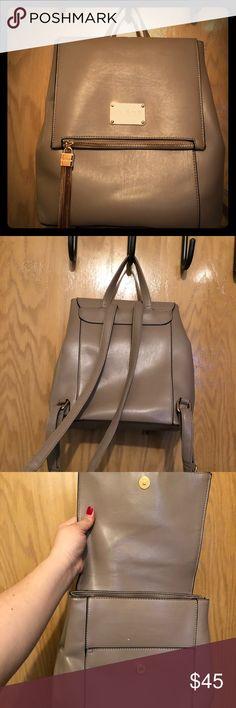 Bebe backpack purse Gold and tan Bebe backpack purse like new! bebe Bags Backpacks