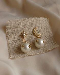 Precious cosmic jewels with pearl and rhinestone embellishments. Ear Jewelry, Dainty Jewelry, Cute Jewelry, Gold Jewelry, Jewelry Accessories, Gold Plated Jewellery, Bridal Jewelry, Gold Plated Earrings, Jewelry Shop