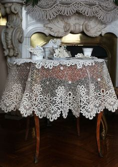 This beautiful tablecloth is made of Russian bobbin lace. Oh what I would give for this beautiful tablecloth. ;) Sooooo beautiful! :))