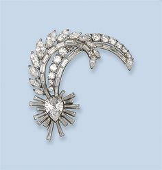 A DIAMOND BROOCH, BY CARTIER -  Of aigrette shape, set with a pear-shaped and baguette centre with two feathers set with marquise-shaped and baguette diamonds, circa 1950
