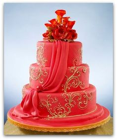 Red draped cake with gold flourish detail