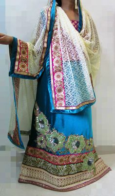 Wear Feisa this wedding season and make heads turn !  Description - Shimmery sea green velvet jodi designed using contrast colored dori work laces with perfectly set sequined, applique flowers and embroidery. A subtle cream colored net dupatta along with vibrant pink blouse adds finesse to this dazzling outfit.