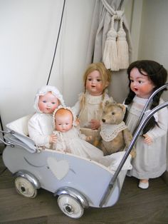 Old doll carriage, love the teddy!