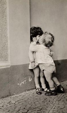 Vintage photo of kids kissing