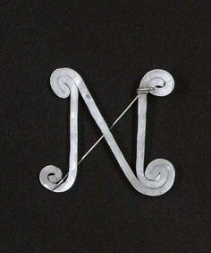 N Brooch    Alexander Calder.  Silver and steel wire.  ca 1948.     Sold by Christies London on 11th December 2003 for GBP 8,813.
