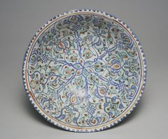 Bowl with Radial Design vessel late 12th-early 13th century Middle East, Iran, Kashan Seljuk-Atabeg period Persian Fritware painted with black (chromium), blue (cobalt), turquoise (copper), and brownish-red (iron) over white lead alkali glaze opacified with tin. Technique: Mina'i 8.5 x 22.1 cm (3 3/8 x 8 11/16 in.)
