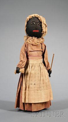 19th century folk art doll.  From Skinner Auction Folk Art Stuffed Cotton Black Doll Auction: 2468 Lot: 394 Sold for: $504