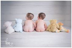 photography ideas with twin girls 6 months old - baby butts with stuffed animals