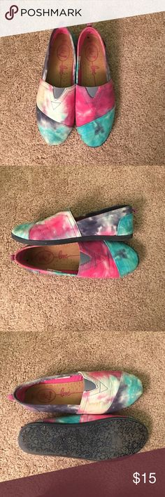 Inspired toms Tie dye slip on shoes. Great condition only worn once. The shoes were purchased just the way they are. I wear size 9 and they fit just fine Rue 21 Shoes