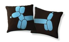 I love the way this adorable balloon dog curls around the edge of this pillow, I think it looks even better paired with a matching piece to create an eye-catching diptych effect. The crisp-white fabric teamed with the sky-blue silkscreen print creates a contemporary feel and will add a flash of fun to your soft furnishings.