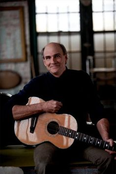 James Taylor (May 02 2012 - Brussels, Belgium Palais des Beaux Arts).  This image takes you to his official site where he's giving on-line guitar lessons!