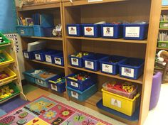 This is part of my math center. Here is where I store the math tubs that hold our manipulatives. The bins and shelves are labeled so the kiddos know where to put things back. I also keep the play doh here and a few other centers as you'll see.