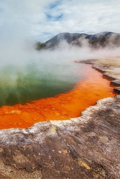 Standing on the edge of the Thermal Pools of Rotorua, New Zealand - There are many reasons to visit New Zealand including adventure travel, hiking, water sports and culture, but capturing the beauty of its diverse scenery is what will make your holiday here most memorable | The Planet D: Adventure Travel Blog