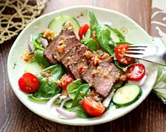 Spicy basil beef salad with three types of basil: Thai, Italian, and lemon basil. The is an Asian-style spicy basil beef salad recipe.
