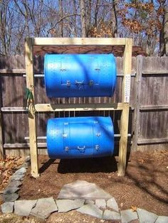 DIY--A compost bin is a necessary companion to My new garden. The darker the barrels, the warmer they get, which is what you want with com...