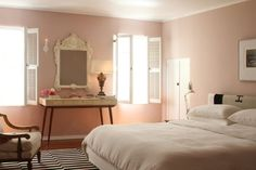 kind of love this shade of pink. it's not too bright. Master Bedroom - Benjamin Moore: Honey Hut, 2102-60 flat. cheers, dana (via apartment therapy)
