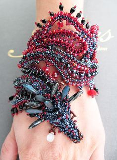 Beaded Dragon Game of Thrones Bracelet by jewelrylace on Etsy The bracelet is created based on the famous film Game of Thrones. It reflects the fate and character of the heroine Khalis Deyeneris Targaryen. Born by storm to reign … Fire dragon wraps the arm, shimmering red, blue, hematite sparks. Dragon guards his owner. Tear of the Dragon in the pendants as moonstone, adularia symbolizes the sadness and pain of losing a loved Drogo. • So Super Awesome is also on Facebook, Twitter...