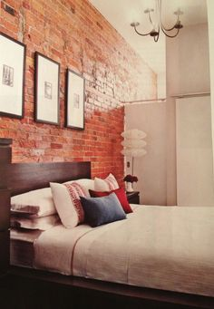i miss our downtown loft that had brick walls and high ceilings like this...