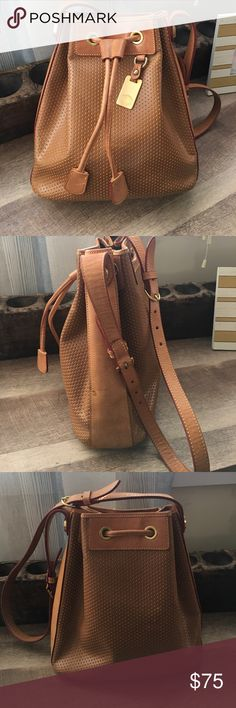 "Dooney and Bourke Leather drawstring bag Good used condition, beautiful unique Dooney leather bag has some ""water"" spots see pictures perfect for fall!!! Dooney & Bourke Bags"
